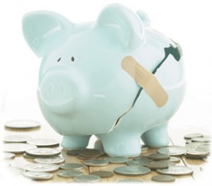 Broken Piggy Bank Traveling vs. Saving