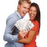 happy couple with money
