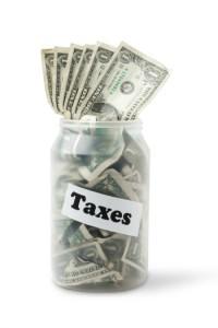 Taxes jar with money inside